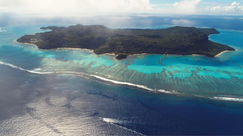 Aerial view of Naitauba Island and surrounding reef.