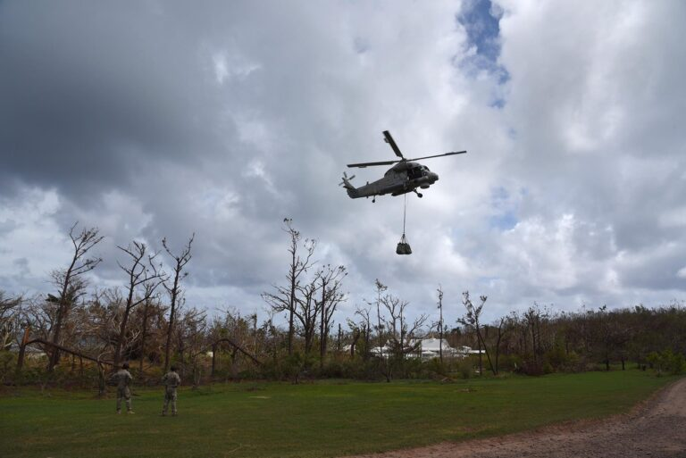 New Zealand Navy helicopter delivering relief supplies for our Fijian friends in Ciqomi.