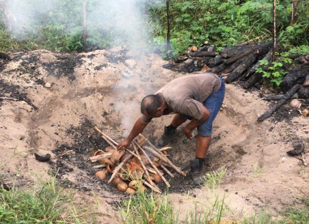 Lighting a fire in a biochar pit.
