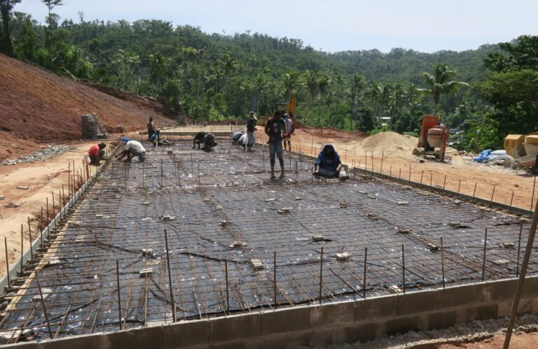 Laying rebar for the concrete floor.